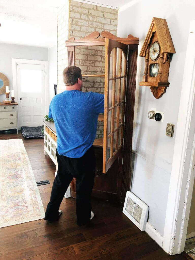 man removing cabinet